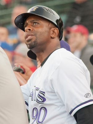 Louisville Bats manager Delino DeShields looks at a Toledo ball hit along the left-field line.