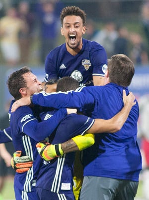 Louisville City FC defender Paco Craig jumps high as he celebrates  with his teammates after clinching the USL eastern conference finals championship.04 November 2017