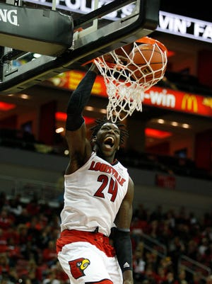 Louisville White team member Montrezl Harrell slams home at basket during the team scrimmage at the KFC Yum ! Center.  The basket did not count however due to a foul.