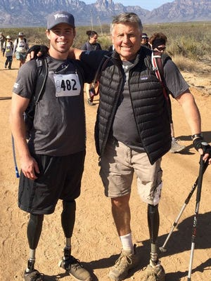 Kirk Bauer, right, poses with retired Army Sgt. Ian Parkinson during the 27th Annual Bataan Memorial Death March, March 20 at White Sands Missile Range.