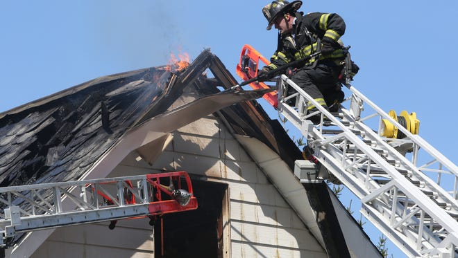 Pelham firefighters and neighboring departments work at a two alarm house fire at 759 Pelhamdale Avenue in Pelham, April 16, 2016.