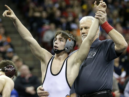 Stratford High SchoolÕs A.J. Schoenfuss points to the crowd after his victory over Fennimore High SchoolÕs Riley Blair after their WIAA Division 3 120-pound State Final Match Saturday, Feb. 27, 2016, at the Kohl Center in Madison, Wis.  Danny Damiani/USA TODAY NETWORK-Wisconsin