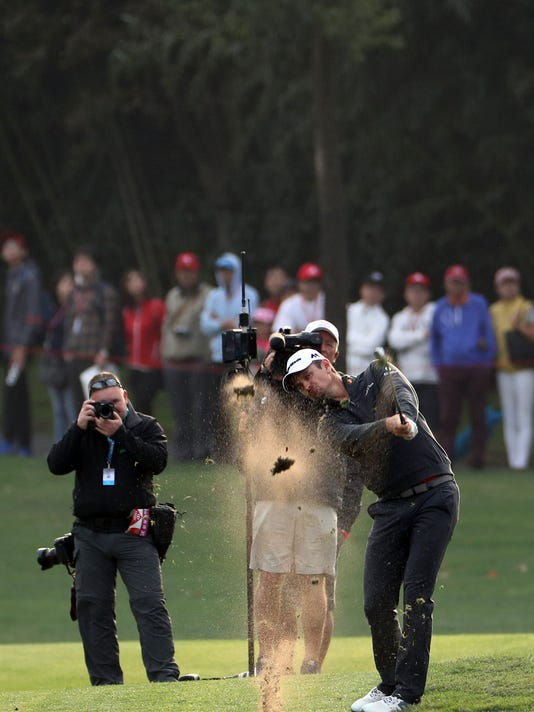Justin Rose of England hits from the fairway during the final round of the 2017 WGC-HSBC Champions golf tournament held at the Sheshan International Golf Club in Shanghai, China, Sunday, Oct. 29, 2017. Justin Rose took advantage of a record-tying collapse by Dustin Johnson and rallied from eight shots behind to win the HSBC Champions.(AP Photo/Ng Han Guan)
