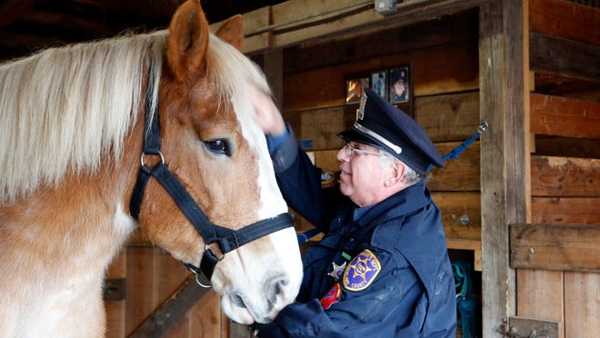 Sheriff's Deputy and instructor Carmine Romeo with Marty, a new member of the department, seen Tuesday at the unit's office. The Rockland County Sheriff's Mounted Patrol Unit survived another budget battle.