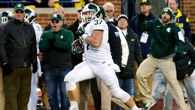 Michigan State fullback Trevon Pendleton (37) runs down the sideline on a 74-yard reception in the third quarter of the Spartans' 27-23 victory over Michigan Saturday, October 17, 2015 in Ann Arbor. Pendelton made it down to the goalline before being tackled. The play was originally ruled a touchdown, but after a review he was ruled down just before the goal line.