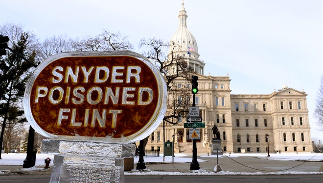 Flint protesters erected a new ice sculpture Thursday across from the Capitol.