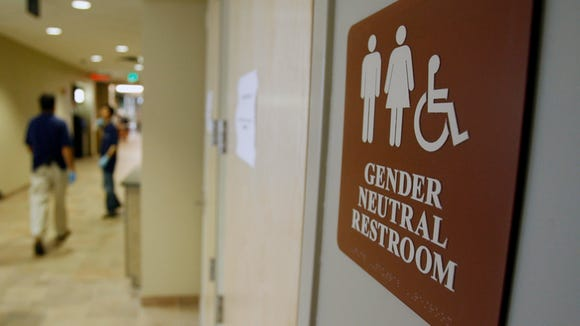 In this file photo, a sign marks the entrance to a gender-neutral restroom at the University of Vermont in Burlington, Vermont.