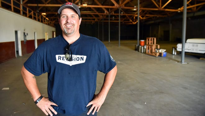 Jeremy Warren, CEO and co-founder of Revision Brewing Co., stands in the newly leased 30,000 square foot warehouse in Sparks. The warehouse will carry one of the largest breweries in the state.