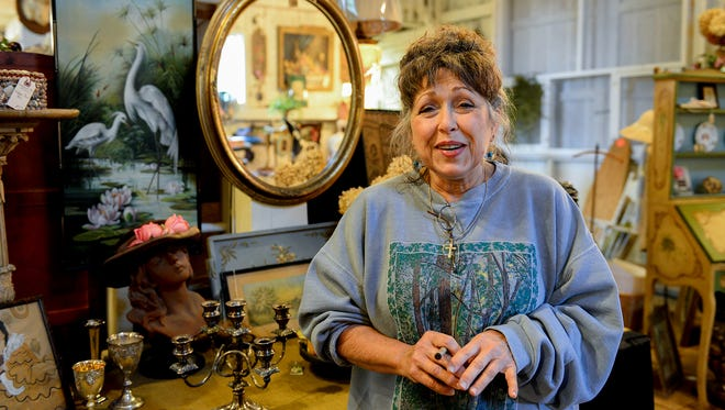 Jill Albert is shown Wednesday in her antique shop on her property near DeWitt. Albert is hosting an antique sale on the farm property her family has owned since 1891.
