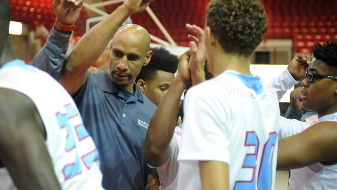 Hirschi head basketball coach Donald Hedge got his 200th win after the Huskies defeated the Oklahoma City Storm 70-46 Saturday, Dec. 3, 2016, in the Wichita Falls Classic at Kay Yeager Coliseum.