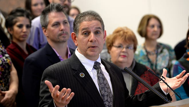 Mayor Virg Bernero and At-Large Council Member Carol Wood, seen to his right, have an opportunity over the next 10 months to repair their relationship and end a longtime feud.