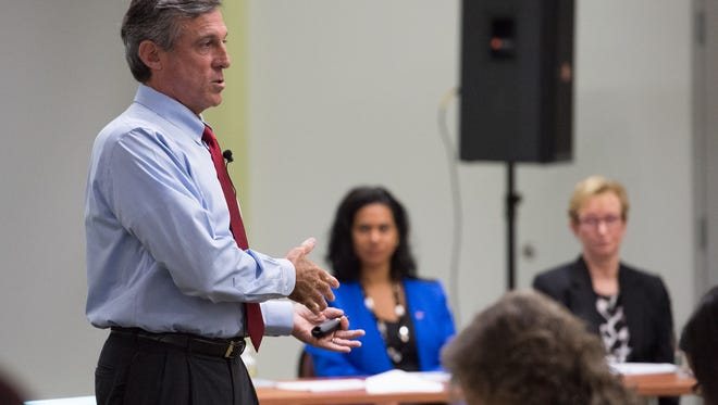 Gov. John Carney talks to state workers to discuss their rising health care cost and ways to save costs during a meeting at Delaware State University in Dover.