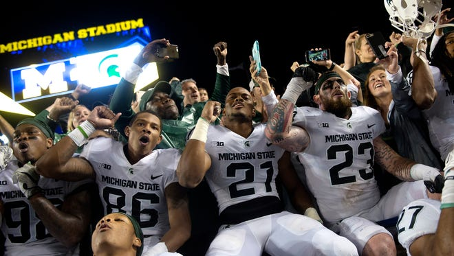Michigan State celebrates after beating Michigan 14-10 on Saturday, Oct. 7, 2017, at Michigan Stadium in Ann Arbor.