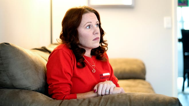Katie Pontifex, a registered nurse working at Sparrow Hospital and and Michigan Nurses Association board member, pauses while she talks about her experience as a nurse at her home in Holt on Tuesday, Dec. 5, 2017.