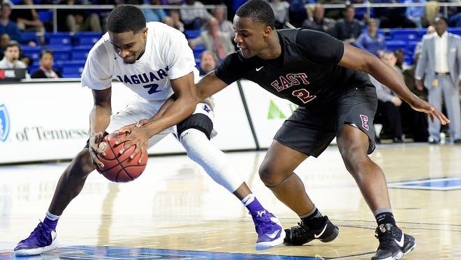 Southwind guard Carlos Marshall (2) is defended by Memphis East guard Alex Lomax (2) during the first half of the Tennessee Division I AAA boys' high school basketball championship game Saturday, March 18, 2017, in Nashville, Tenn. (AP Photo/Mark Zaleski)