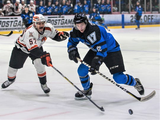Paul Cotter (right) enjoyed a productive rookie season in the US Hockey League with the Lincoln Stars.