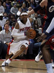 Detroit Pistons Allen Iverson drives against Zydrunas