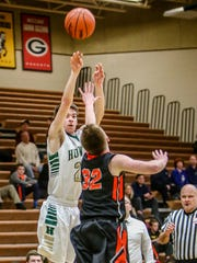 Howell's Dan Zolinski, who scored 20 points, shoots over Brighton's Dalton Porth.