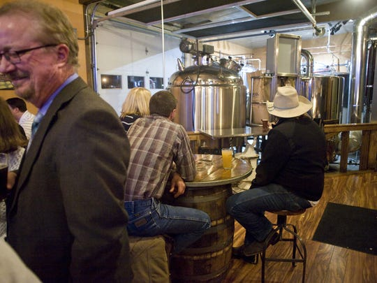 Triple Dog Brewery patrons enjoy drinks in a seating