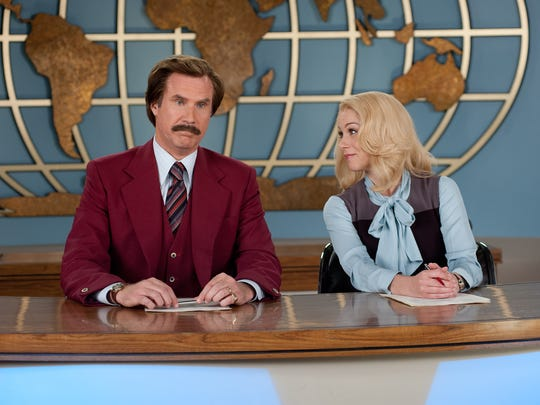 """Will Ferrell as Ron Burgundy, left, and Christina Applegate as Veronica Corningstone in a scene from """"Anchorman 2: The Legend Continues."""""""