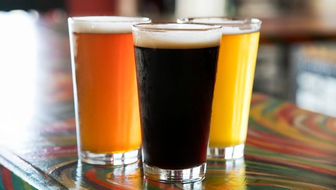 Most of Cape Coral Brewing Company's beer names have a Cape Coral theme such as the Bad Buoy IPA, left, Burrowing Owl Brown Ale, center, and Gongoozler Ale. A gongoozler is a person who has an interest in canals or enjoys watching activity on canals.