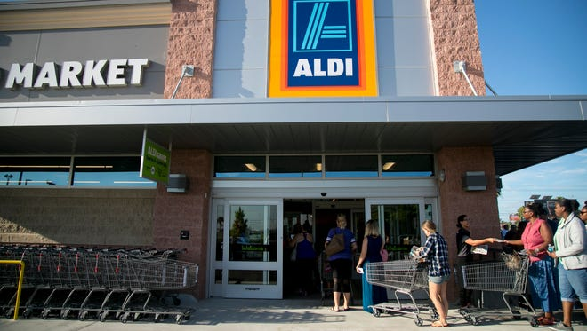 The first customers pour into ALDI in Fort Myers on Thursday for the store's grand opening.