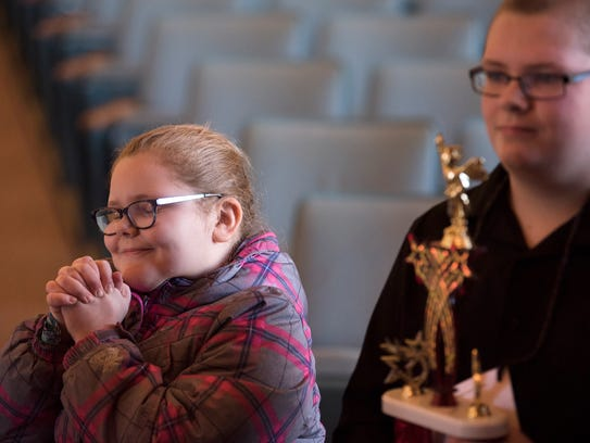 Piper Bevan, 9, of Buchanan, becomes excited as she