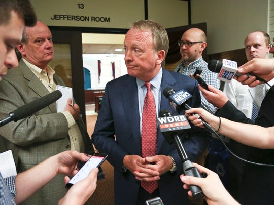 "University of Louisville interim President Greg Postel talks to the media after a special board of trustees meeting where he proposed a separation of the university and its hospital.  ""Health care is evolving rapidly ... and there are a lot of question marks,"" Postel said."