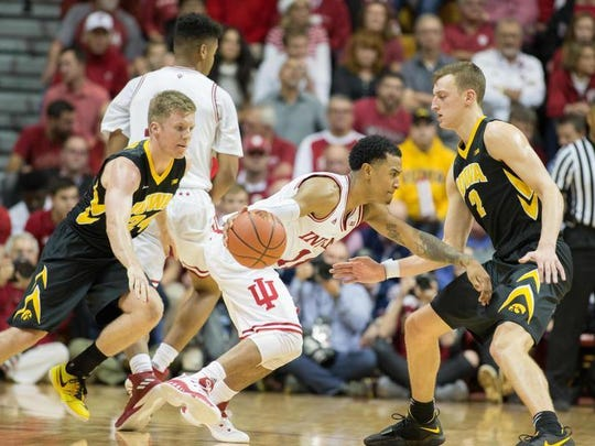Indiana Hoosiers guard Devonte Green (11) dribbles the ball while Iowa Hawkeyes forward Jack Nunge (2) and guard Brady Ellingson (24) defend in the second half of the game at Assembly Hall.