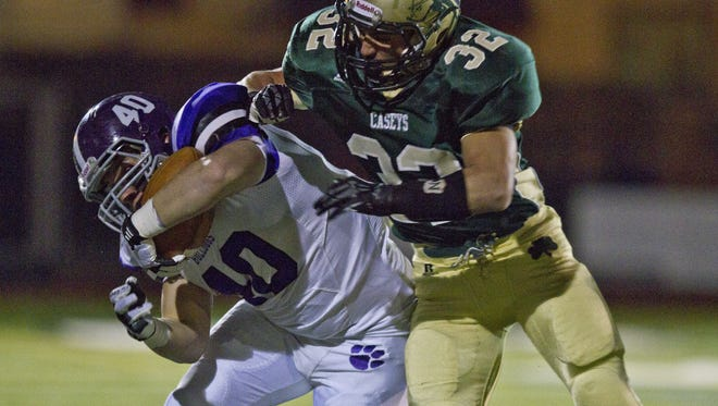 Rumson-Fair Haven's Dylan Zohn is knocked out of bounds by RBC's Michael Cordova during the 2013 edition of the school's Thanksgiving Week rivalry game.