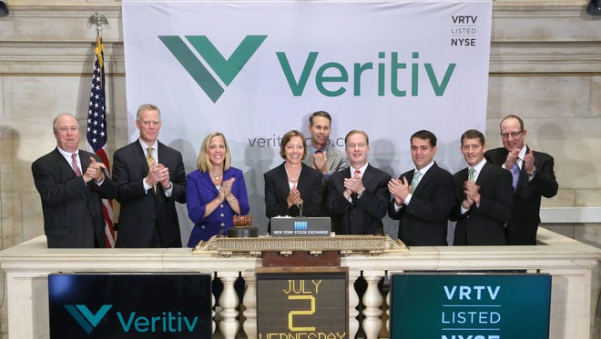 Mary Laschinger, fourth from left, chairman and CEO of Veritiv, joins with other executives to ring the opening bell at the New York Stock Exchange on Wednesday. Veritiv was formed when xpedx and Unisource Worldwide Inc. merged.