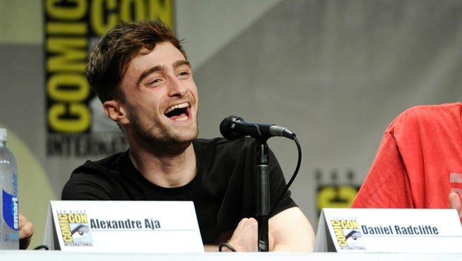 """This July 25, 2014 file photo shows actor Daniel Radcliffe at the RADiUS-TWC """"Horns"""" panel on Day 2 of Comic-Con International in San Diego. Radcliffe was at Comic-Con International in San Diego promoting one of his two upcoming films, the darkly comic horror tale ?Horns.? In it, he plays a man accused of killing his girlfriend who grows horns that prompt people around him to reveal their darkest secrets."""