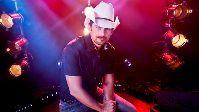 """American country singer-songwriter and musician Brad Paisley poses for a portrait, Thursday, Aug. 28, 2014, in New York. Paisley cranks up the fun and avoids controversy on his new album """"Moonshine in the Trunk."""""""