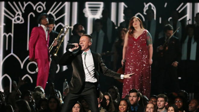 "Couples are wedded as Macklemore, pictured, and Ryan Lewis, Mary Lambert, Trombone Shorty and Madonna perform ""Same Love"" at the 56th Annual Grammy Awards at Staples Center in Los Angeles on Sunday, Jan. 26, 2014. (Robert Gauthier/Los Angeles Times/MCT)"