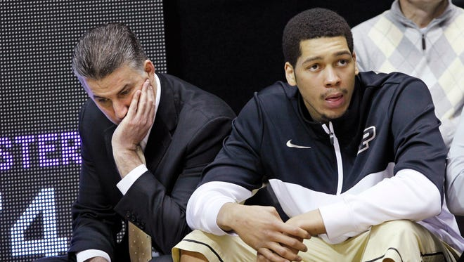 Purdue coach Matt Painter, left,  ponders after Northwestern upended the Boilermakers 74-65 March 9, 2014, in West Lafayette, Ind.
