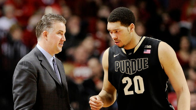 Purdue head coach Matt Painter, left, talks with Purdue center A. J. Hammons (20) during the second half in Lincoln, Neb., on Sunday, Feb. 23, 2014.
