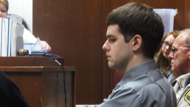 Seth Techel sits in a in Davenport, Iowa  courtroom on Tuesday, July 22, 2014 during his trial for first-degree murder in the May 2012 death of his pregnant wife, Lisa Techel. His lawyers rested their case Tuesday, seeking to cast doubt on the fairness of the investigation.