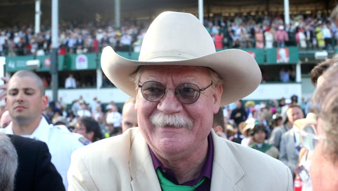 Co-owner of  California Chrome Steve Coburn celebrates after California Chrome wins the 140th Kentucky Derby at Churchill Downs. May 3, 2014