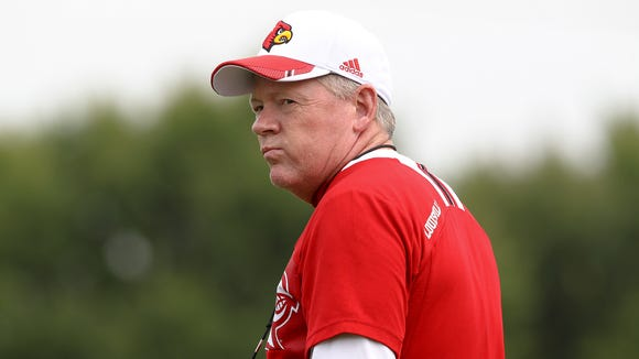 Bobby Petrino looks back at his team as he takes the field. August 5, 2014