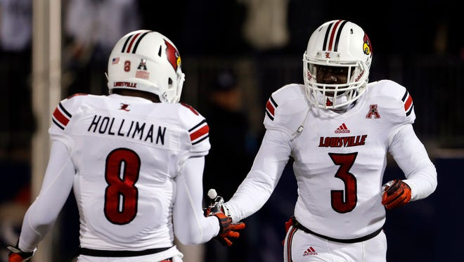 Nov 8, 2013; East Hartford, CT, USA; Louisville Cardinals cornerback Charles Gaines (3) reacts after with teammate safety Gerod Holliman (8) after his touchdown against the Connecticut Huskies in the first quarter at Rentschler Field. Mandatory Credit: David Butler II-USA TODAY Sports