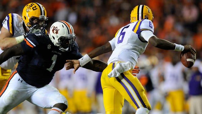 Auburn defensive lineman Montravius Adams chases down LSU quarterback Brandon Harris at Jordan-Hare Stadium in Auburn, Ala. on Saturday October 4, 2014.