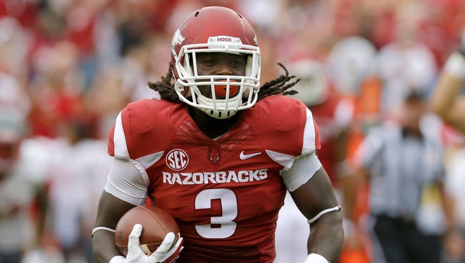 Arkansas running back Alex Collins leads a ground attack that enters today's game against Texas Tech ranked 11th in the nation in rushing (324.5 yards per game)