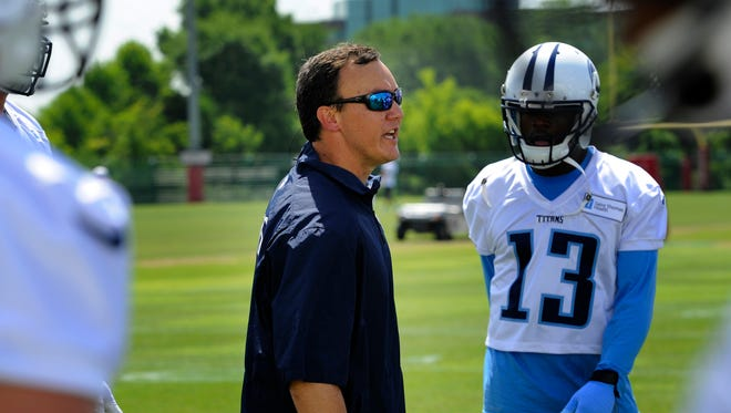 Titans offensive coordinator Jason Michael gives instructions to offense during practice Tuesday at St. Thomas Sports Park.