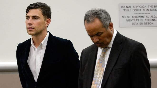 Vitalii Sediuk (L) and lawyer Anthony Willoughby appear at Los Angeles Superior Court House on May 30, 2014 in Los Angeles.