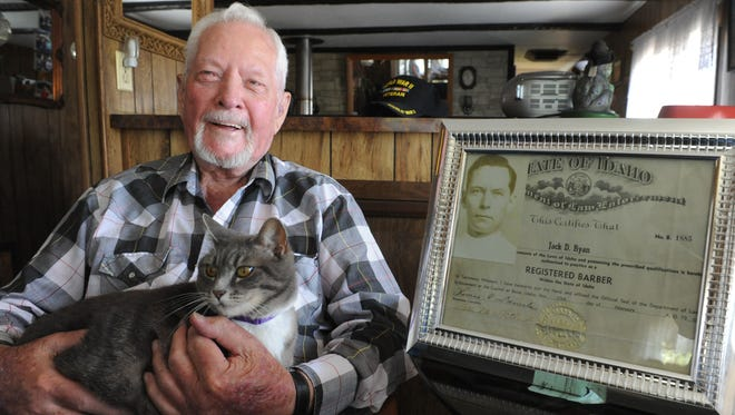 Jack Ryan, 91, just retired from a decades-long career as a barber. He lives in Sun Valley in a home he shares with his cat Sara. At right is a 1952 license to barber in Idaho.