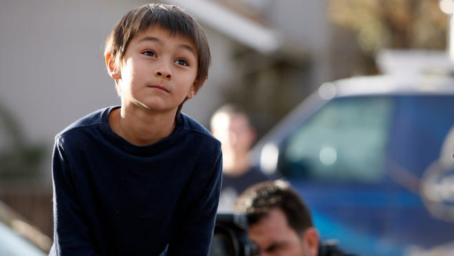 Six-year-old Falcon Heene sits in the box of his family's pickup truck outside their family's home in Fort Collins, Colo., after he was found hiding in a box in a space above the garage on Thursday, Oct. 15, 2009.