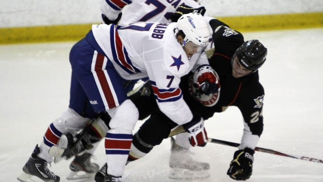 Rochester's Brayden McNabb, left, checks Wilkes-Barre's Dominik Uher at the blueline during AHL exhibition hockey action between the Wilkes-Barre/Scranton Penguins and the Rochester Americans at the Sports Centre at MCC in Henrietta Wednesday evening, October 3, 2012.
