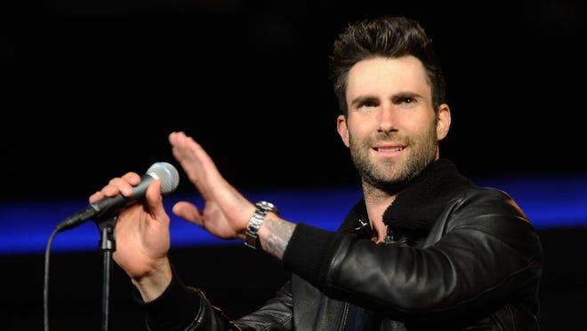 Singer Adam Levine of Maroon 5 arrives to perform during a keynote address at the 2013 International CES at The Venetian on January 7, 2013 in Las Vegas, Nevada.
