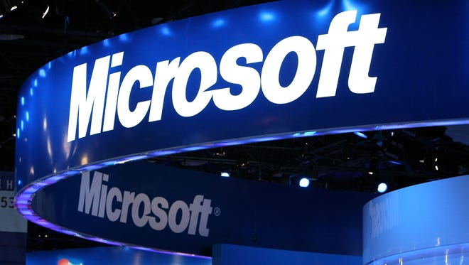 The Microsoft logo is displayed over the Microsoft booth at the 2010 International Consumer Electronics Show at the Las Vegas Hilton January 7, 2010 in Las Vegas, Nevada.