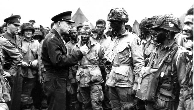 """Gen. Dwight D. Eisenhower gives the order of the day, """"Full victory - nothing else,"""" to paratroopers somewhere in England, just before they boarded their airplanes to participate in the first assault in the invasion of the continent of Europe on June 6, 1944."""